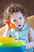 Little Girl talking on a toy phone — Stock Photo