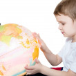 Clever little boy looks at the globe — Stock Photo