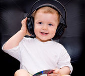 Little baby with headphones — Stock Photo