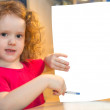 Little girl holding a blank paper — Stock Photo #20975123