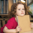 Little girl holding a book — Stock Photo