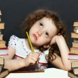 Stock Photo: Small girl thought about lessons