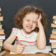 Small girl thought about lessons — Stock Photo