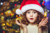 Beautiful little girl in Santa hat — Stock Photo