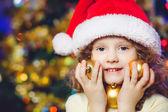 Beautiful little girl in Santa hat — Stock Photo