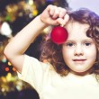 Girl holding a Christmas ball — Stock Photo