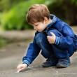 The boy draws on asphalt — Stock Photo