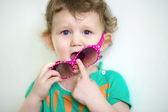 Funny little baby with glasses — Stock Photo