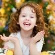 Beautiful little baby girl looking at the camera and smiles on — Foto Stock