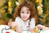 Beautiful little baby girl looking at the camera,on the backgr — Stock Photo