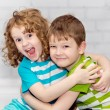 Happy brother and sister smiling and embracing. — Stock Photo #37645297
