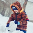 Stock Photo: Portrait of charming baby, surrounded by snow