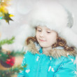 Stock Photo: Winter portrait of blue-eyed baby in white furry hat, close-up h