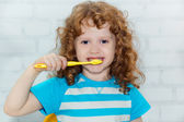 Portrait of the little girl brushing her teeth — Stock Photo