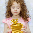 Stock Photo: Frustration girl looking at gifts.