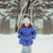 Winter portrait of a laughing girl in a purple coat with polka d — Stock Photo