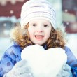 Beautiful little girl happily playing snowballs in winter park o — Stock Photo #38729019