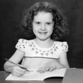 Black and white portrait, the beautiful girl holding pen and mak — Stock Photo