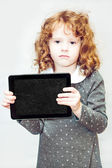 Clever girl holding a blackboard. — Stock Photo