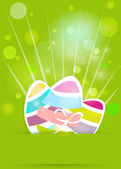 Coloridos huevos sobre la hierba fondo de pascua. — Vector de stock