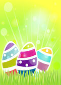 Colorful eggs on grass Easter background. — Stock Vector