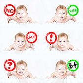 Collection of baby pictures with a sign in his hand. — Stock Photo