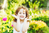 Cute little girl playing peekaboo. — Stock Photo