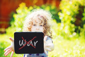 """Little girl hold tablet pc, toning photo.On the tablet text """"No — Foto Stock"""