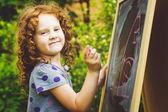 Girl writes in chalk on a blackboard. Education concept. Toning  — Foto Stock