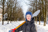 Boy with a shovel after a snow fall. — Stock Photo