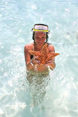Starfish and Girl — Stock Photo