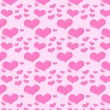 Seamless pattern of pink hearts — Stock Vector