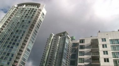 Time lapse of tall condominiums in Vancouver Canada during beautiful partly cloudy day. — Stock Video