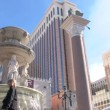 Stock Video: LAS VEGAS, NEVAD- CIRC2012 - Las Vegas Boulevard Strip and VenetiHotel and Casino with walking by on sunny day.