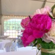 Tented wedding setting viewing large floral centerpieces . — Stock Video #15386815