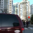 VANCOUVER, BRITISH COLOMBIA - CIRCA OCTOBER 2010 :Time lapse of very busy intersection and high rise buildings in Vancouver, Canada during the 2010 Olympic Winter Games. — Stock Video #19296563