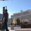 LAS VEGAS, NEVADA - CIRCA 2012: Las Vegas Boulevard Strip with many walking by on sunny day. — Stock Video