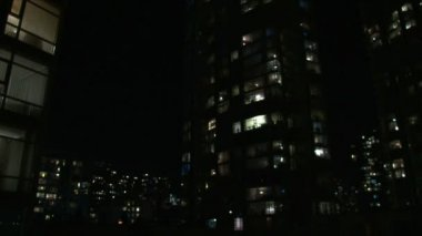 Time lapse of city life at night in Vancouver Canada showing many in their condominium homes turning on and off their lights. — Stock Video