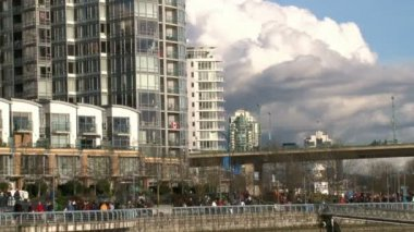 VANCOUVER, BRITISH COLOMBIA - CIRCA OCTOBER 2010 :Time lapse of very busy water front and high rise buildings in Vancouver, Canada during the 2010 Olympic Winter Games. — Stock Video
