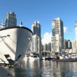 Yachts in the port amid skyscrapers — Wideo stockowe