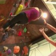 Girl climbing up the wall — Stock Video