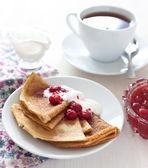 Pancakes with raspberry jam — Stock Photo