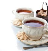 Elegant tea cups and freah meringues — Stock Photo