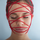 Woman constrained with red ropes. — Stock Photo