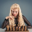 Woman playing chess. — Stock Photo #14113717