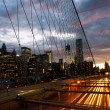 Stock Photo: Manhattan skyline from the Brooklyn bridge at dusk with cars tra