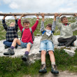Stock Photo: Kids playing in mountains lifting club. Dolomites, Italy.