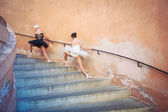 Young beautiful ballerinas dancing on the stairs. Ballerina proj — Stock Photo