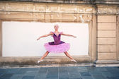 Young beautiful ballerina jumping in Bologna - Pincio, Italy. Ba — Stock Photo