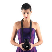 Beautiful young woman with medium format camera against white ba — Stok fotoğraf